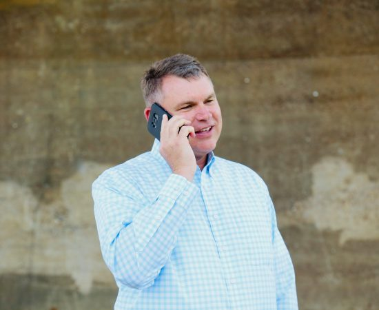 Don Odom, owner of SuccessPath talking on phone